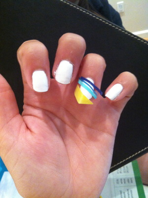 I painted a strip of tape blue, purple, light blue, and yellow then placed them on my nails. I then cut the edges off and put a glaze over it so they would stick. Came out well :)