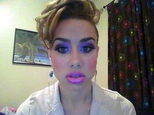 Purple eyeshadow + pink lips.