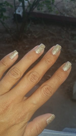 Lit Glitter in champagne wishes applied over a nude tan polish, I dip my quick dry in the glitter and covered nail (: