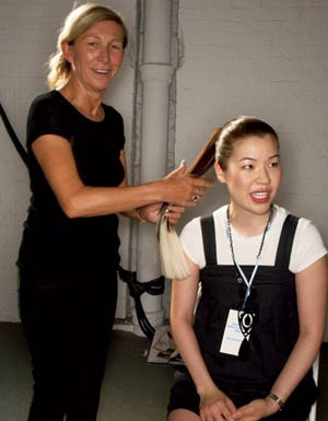 Legendary hairstylist Odile Gibert smoothing out my faux blond-tipped ponytail backstage at Rodarte.
