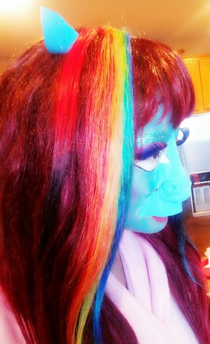 I had to finish the look off with Rainbow hair.I can't explain where my mind takes me when it comes to makeup :)