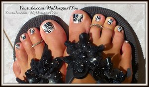 BLACK AND WHITE TOENAIL DESIGN