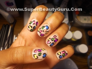 Colorful Leopard Print Nail Tutorial: http://superbeautyguru.com/colorful-leopard-print-nail-tutorial/