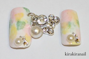 """I came up with this easy design to match the nail dangle (http://www.bornprettystore.com/shining-crystal-rhinestone-pearl-charm-silver-dangle-ring-nail-decoration-p-5606.html) I got from bornprettystore.com to review:) (site-wide 10% off coupon code: KIKW10)  Products I used: Nr. 370 by f.flormar (white) """"lovely moment"""" (130) by p2 (pastel pink) 1364AC by ONLY (Manhattan) (pastel yellow) """"Mermaid's tears"""" (Nr. NL P18) by OPI (mint)  Base & top coat"""