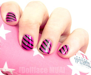 [stripage] just some fun, simple stripes atop of a bright fuschia/purple by cosmetic arts nail polish- sorry the polish doesn't have a name- i know- weird right?