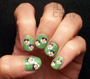 did a little twist on Nailed It's tutorial!!! http://www.thelittlecanvas.com/2013/06/pansy-nail-art-tutorial.html