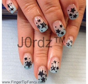 http://fingertipfancy.com/black-stars-light-blue-fade-nails