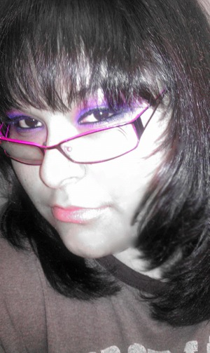 pink and purple eye shadow with a light pink lip