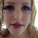purple and black style. lashes to bolden the 'moulin rouge' style