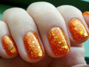 Created using The Face Shop Nail Color OR203 and OPI Crown Me Already! They look like orange candy on my fingertips :)