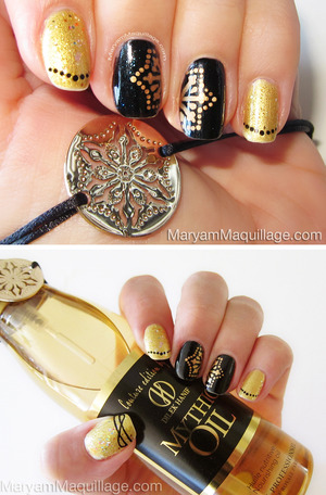 hand-painted nail art, details here: http://www.maryammaquillage.com/2013/05/my-mythic-oil-experience-couture.html