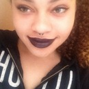Dark eyes, dark lips.