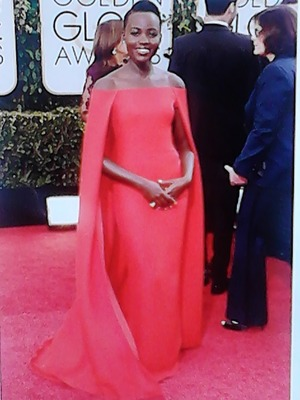 this dress is one of the most stylish dresses worn on the golden globe red carpet last night. One of the only ladies who took risk. three words: fabulous,fearless, flawless..... lupita nyongo definitely werked!!!