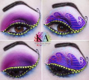 As requested, I've designed a look inspired by BOTH Cheshire cats. I have the traditional pink and purple and underneath I have the blue. There are stripes in there, but you cant see them because of my lashes. Boo!   I wanted to incorporate the smile into the look. Originally I was going to do just white, but I found the yellow stood out WAY more! I've done two versions of this look. One without the funky details and one with.   Those teeth were a PAIN! The liquid eyeliner kept catching all of the lashes and... buh. Took way too long! haha!   WHICH DO YOU PREFERRRR? I couldn't decide which I liked better!
