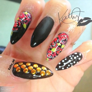 Black long stiletto nails with red hand painted roses and studs