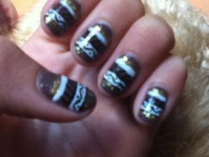 Brown tribal nails
