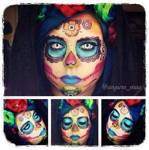 I am back with another Dia De Los Muertos look!  I made this look for ones who need a last minute costume  for halloween. I used temporary tattoos, but made it my own by adding color and changing the patterns around.   I used all Sugarpill products, and made the flowers out of hair.   Enjoy!