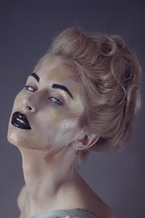 black eyebrows, black glossy lips, gold pattern, updo