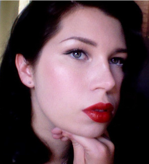 retro look with coral/champagne cheeks and lids and MAC's Russian Red lipstick.