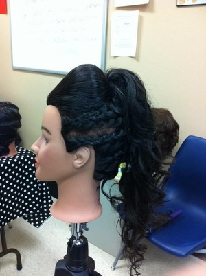 So this is a updo I done when I was in hairstyling . What I done was put a big bump in the front then braided the sides to do like a mowhawk an just curled the hair!