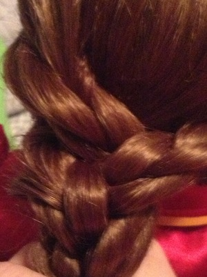 All you do is just take 3 braids and braid them. Thus isn't my hair this my old American girl and now I do it's hair