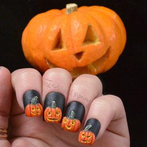 http://www.thepolishedmommy.com/2014/10/nail-o-lanterns.html