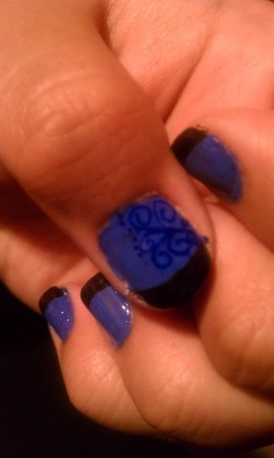 PAINT ENTIRE NAIL WITH BLUE POLISH ALLOW TO DRY THEN PAINT THE TIPS WITH BLACK POLISH. ONCE DRIED MAKE SOME SWIRLS AND DOTS WITH A LIGHTER BLUE POLISH, ONCE DRIED APPLY A CLEAR COAT TO SEAL IN DESIGN