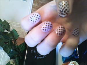 Bundle Monster polka dots stamped with Revlon Hot for Chocolate over Sinful Colors Bubbly.