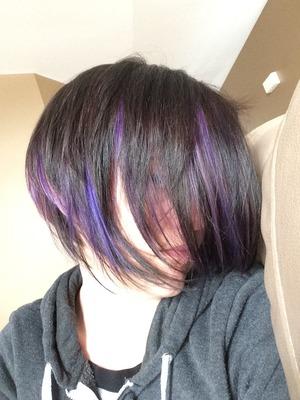 Purple peek-a-boo with dark brown hair.