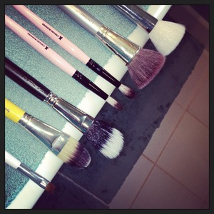 I clean my makeup brushes every Sunday and this is how I dry them, by hanging the bristles off the edge of the counter.