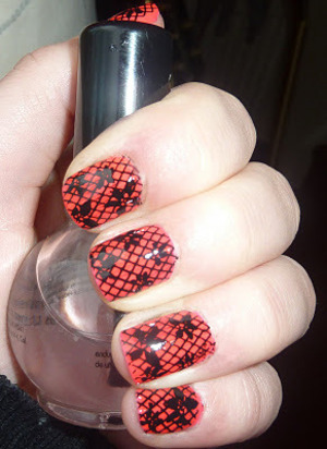Black & Red Lace Nail Art I used the Konad nail stamping set to create this design. I stamped my nails with the Konad m57 flower design first and then went over every nail with the Konad m57 fishnet design.  Hope you like it! Thanks Sophie  x