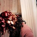 Red/blonde/black hair. Layered curls