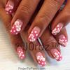 Pink Polka dot nails with bows