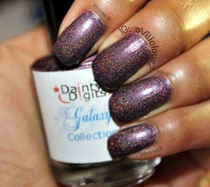 Two coats of Dainty Digits Jumpin' Jupiter Flash without topcoat. A deep purple holographic.