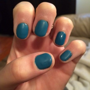 gel nails using Gelish Matte Top it Off and regular Top it Off on ring finger nail