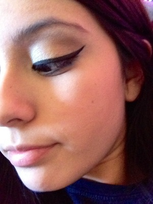 By using an angled Mac brush in gel liner
