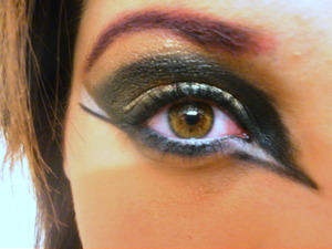 Gold, black, and white with a pink brow.