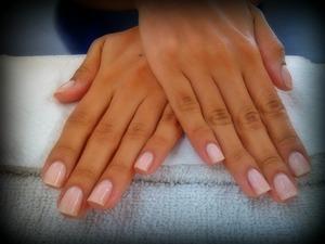 A simple manicure, super light pink/peach nail polish