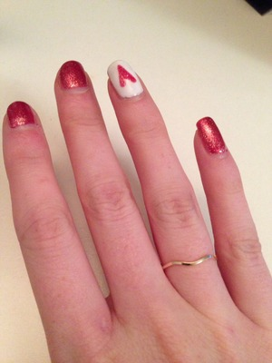 Red glitter shellac with white nail, red heart glitter detail