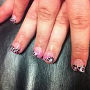 Leopard print tips with pink glitter.
