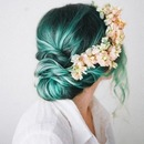 Low bun with a floral touch