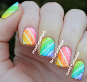 I decided to do a colorful gradient using some striping tape! I used Sally Hansen Xtreme Wear White On as the base color and the gradient was done using acrylic paint and a sponge.