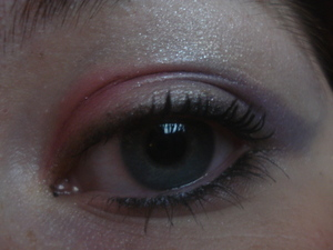 Pink and blue with a flick with white blended up light eyeliner and heavy mascara