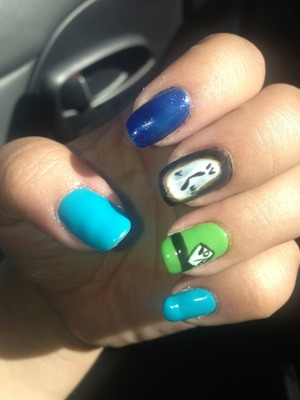 Blue and blue glitter, Disney nails with a melting clock and the mad hatter design