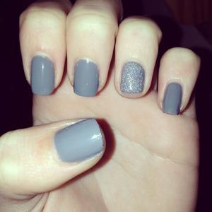 Grey nail varnish with glitter