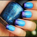 Sexy blue nails with glitter tips.