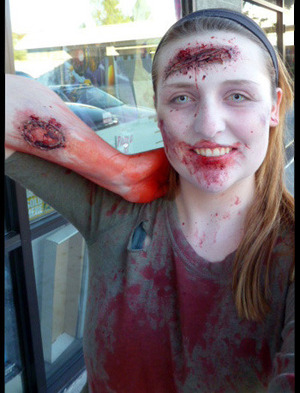 Gory zombie look with prosthetic wounds and costume contact lenses. For a tutorial, please see my blog post here: http://egwarfield.blogspot.com/2013/07/halloween-zombie-step-by-step-tutorial.html