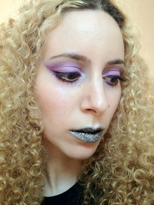 I started with a crazy idea for some Holographic Space-age lips then had some fun with light purples around the eyes. For some reason M.A.C 3D silver makes me want to use purple with it and what better purples to use but Sugarpill Poison plum, Paperdoll, M.A.C Vellum and my new beautiful Inglot shadows I got recently.