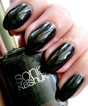 a rich black base with micro silver glitters scattered throughout http://www.beautybykrystal.com/2013/04/sonia-kashuk-starry-night.html