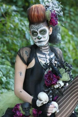 Day of the Dead makeup and hair I did for a competition while in beauty school. Won 1st place!